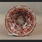 Patera czerwona z chłopcem w barokowym stylu