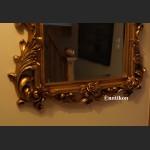 Lustro w złotej ramie z liśćmi akantu