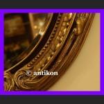 Stylowe owalne lustro dużę w złoconej bogatej ramie